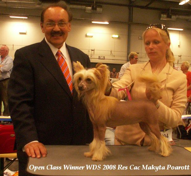 Makyta with her owner and judge Mr. Rafael de Santiago